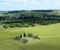 fricourt-new-military-cemetery-with-the-tambour-duclos-behind