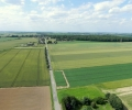 looking-north-west-up-road-from-guillemont-towards-longueval-delville-wood-the-cwgc-cemetery-can-be-seen-on-right-of-image