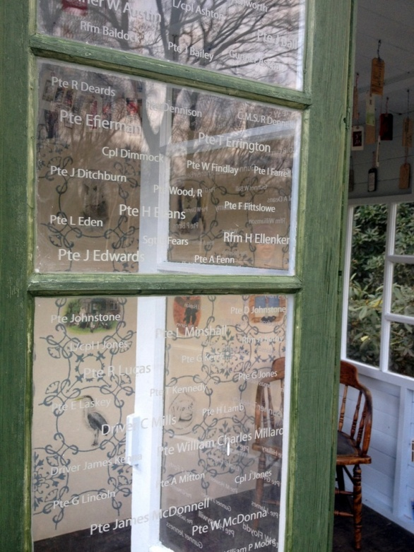 Windows etched with the names of soldier patients