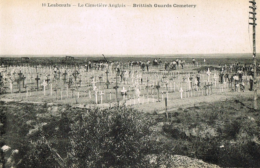 Postwar image of Guards Cemetery, Lesboeufs. The contrast between the haphazard crosses in this postcard and the neat rows of Portland headstones that greet the modern visitor is testament to the skill and dedication of the CWGC.
