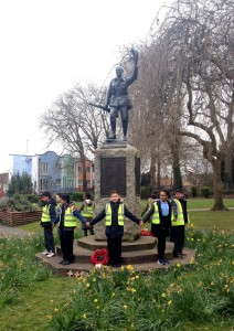 The children holding hands, forming a protective ring around Fishponds War Memorial, March 2016